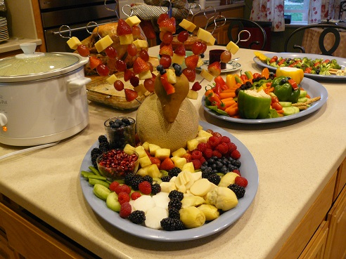 Thanksgiving Food Tips from Holidays and Observances - pictured is a Fruit Turkey Tray and a Veggie Turkey Tray